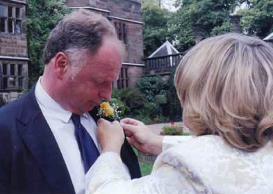 Missy pinning flowers on Dan.