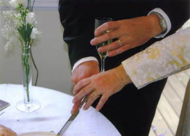 Showing the rings as we cut the cakes (yes, plural).