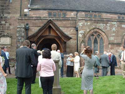 Outside the church as Missy & Mike have just exited.